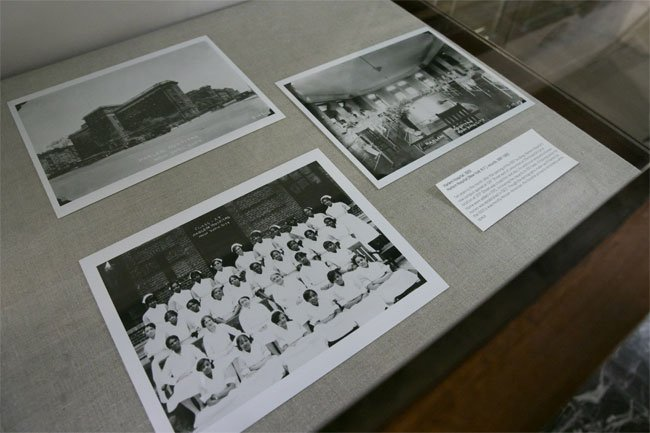 The NYAM Library displays archival Harlem Hospital photos in the lobby prior to the event