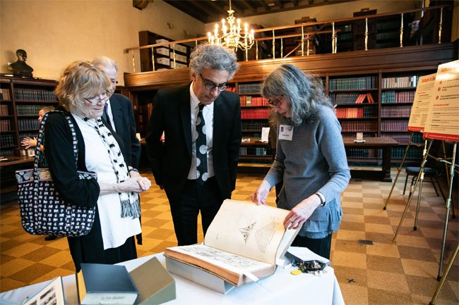 Arlene Shaner and John Colapinto discuss a NYAM Library book used in John's research for his upcoming book.