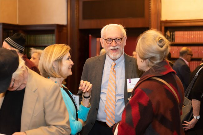 Dr. Paul Theerman, Director interacts with Academy Library donors.